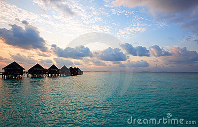 Island in ocean, Maldives . Villa on piles on wate