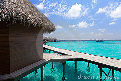 Island in ocean, Maldives. Villa on piles on water