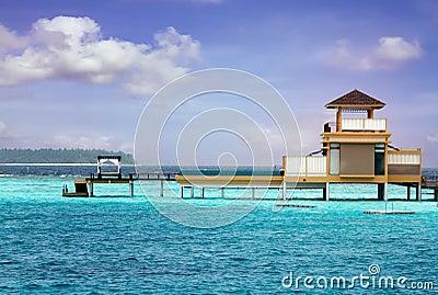 Island in ocean, overwater villa. Maldive