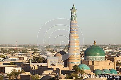 Islom Hoja Minaret and Madrasa in Khiva Stock Photo