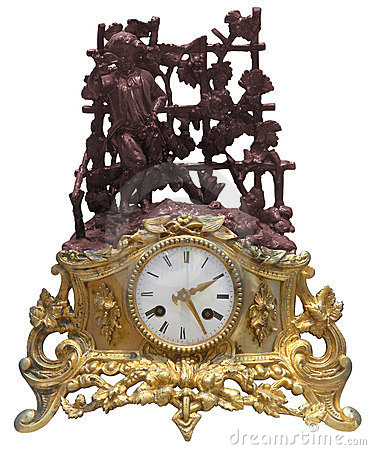 Isolated antique golden table clocks with statuette