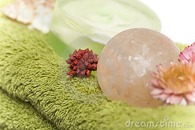 Isolated close-up of spa towels, soaps and flowers
