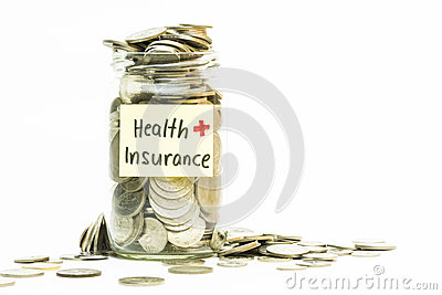 Isolated coins in jar with health insurance label