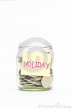 Isolated coins in jar with holiday label