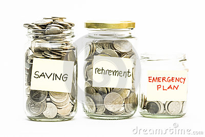Isolated coins in jar with saving, retirement and emergency plan label