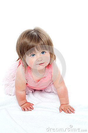 Isolated curious pretty girl child crawling