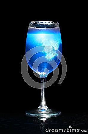 Isolated glass with blue splashing beverage