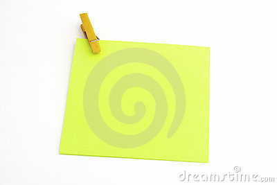 Isolated green paper with yellow clamp