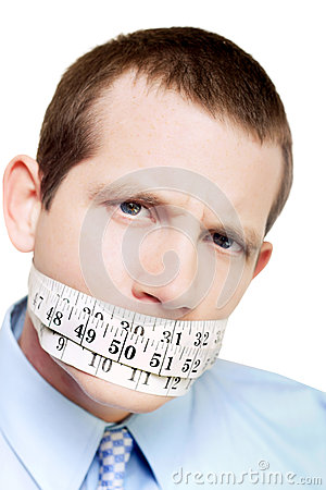Isolated man with tape measure around mouth