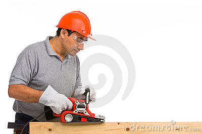 Isolated manual worker using an electric sander