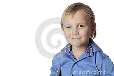 Positive smiling boy with touch screen