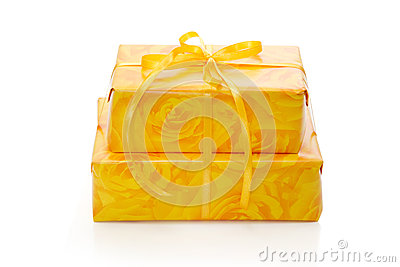 Isolated presents wrapped in yellow patterned paper