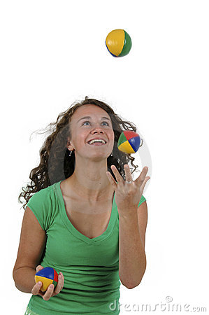 Isolated teenage girl juggling