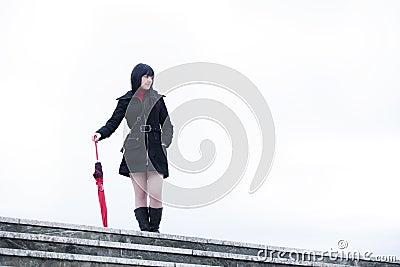 Isolated umbrella girl