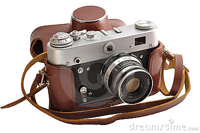 Isolated used film photo-camera in leather case