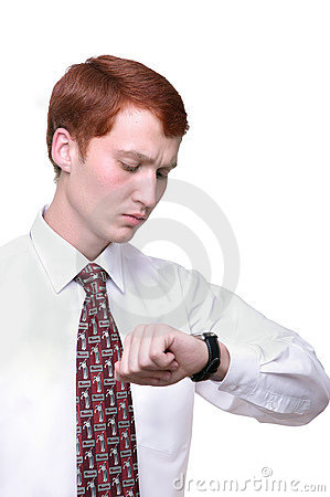 Isolated young man checking time looking at his wa