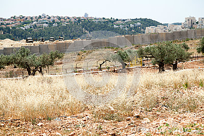 Israeli Army by the Wall of Separation Editorial Image