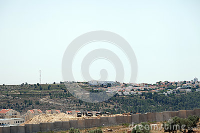 Israeli Army by the Wall of Separation Editorial Stock Photo