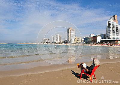 Israeli man sit and read along Tel-Aviv beach Editorial Stock Photo