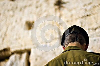 Israeli soldier praying at the wailing wall, Jerusalem Israel