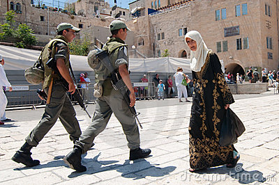 Israeli Soldiers and Palestinian Woman Editorial Stock Image