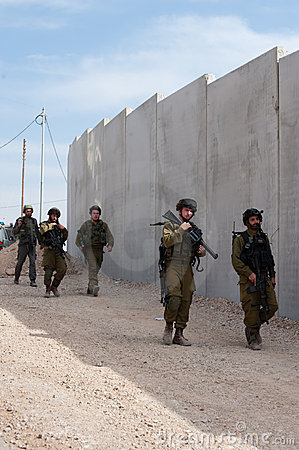 Israeli Soldiers and Separation Barrier Editorial Photo