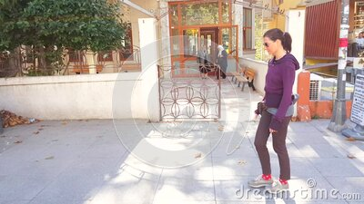 Caucasian woman walking alone near stores in Bagdat Street at the weekend. Istanbul, Turkey - October 05, 2018: Side view of a young Caucasian brunette woman in stock video