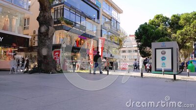 Unrecognizable people walking on the street on their leisure times. Istanbul, Turkey - October 05, 2018: Unrecognizable people walking on popular Bagdat Avenue stock footage
