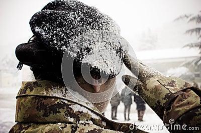Italian army woman under the snow