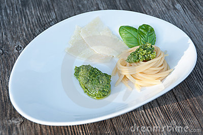 Italian basil pesto with spaghetti and parmesan