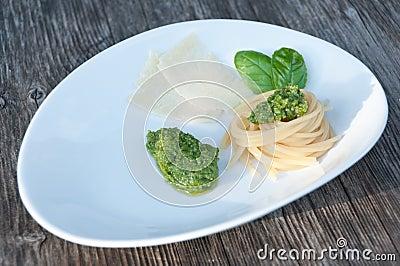 Italian basil pesto with spaghetti and parmesan