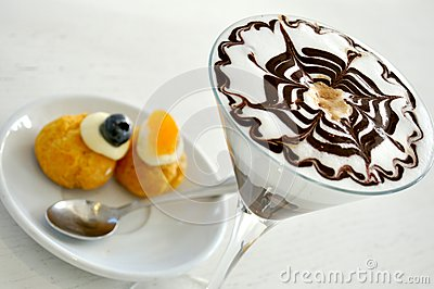 Italian breakfast with cappuccino and sweets