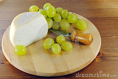 Italian cheese with knife and grapes