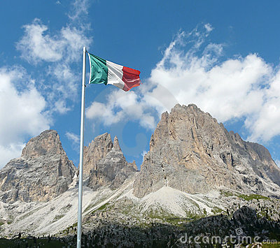 Italian flag in front of Dolomite mountains