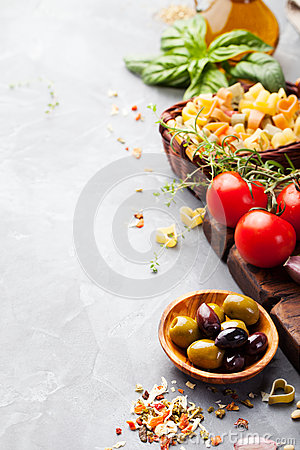 Free Italian Food Background With Vine Tomatoes, Basil, Spaghetti, Olives Ingredients On Stone Table Copy Space Stock Image - 66838711