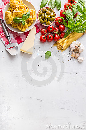 Free Italian Food Cuisine And Ingredients On White Concrete Table. Spaghetti Tagliatelle Olives Olive Oil Tomatoes Parmesan Cheese. Stock Image - 98177311