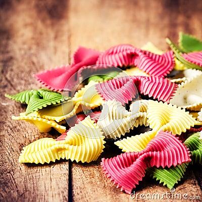 Italian Food - Fresh Italian Pasta on old wooden background clos