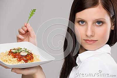 Italian food - portrait healthy woman spaghetti