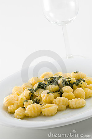 Italian gnocchi with pesto sauce.