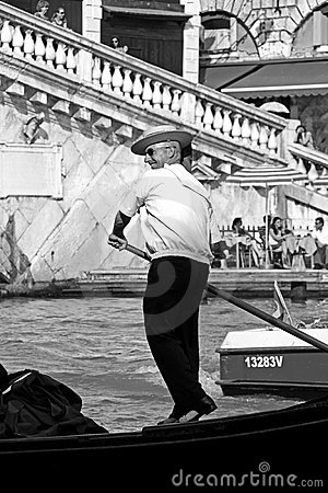 Italian gondolier and tourists Editorial Photo