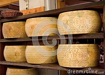 Italian Grana Padano DOP cheeses Editorial Photo