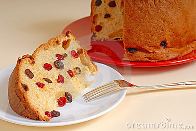 Italian Panettone Christmas bread with tan background