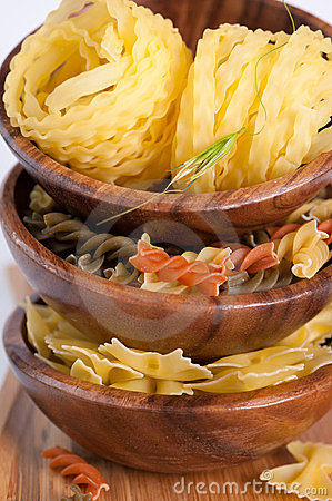Italian pasta in a wooden bowl