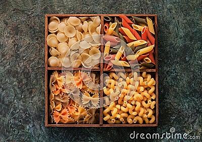 Italian pasta in wooden cells