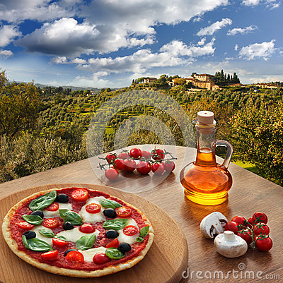 Free Italian Pizza In Chianti Against Olive Trees And Villa In Tuscany, Italy Royalty Free Stock Images - 33232019
