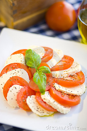 Italian salad with tomatos and mozarella cheese