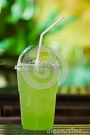 Kiwi Mix soda in plastic cups.
