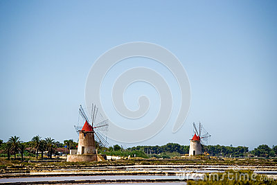 Italy Sicily Two Old Windmills near salt lake