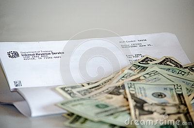 IRS letter and money Editorial Stock Image