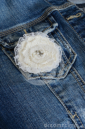 Ivory flower broochon denim background